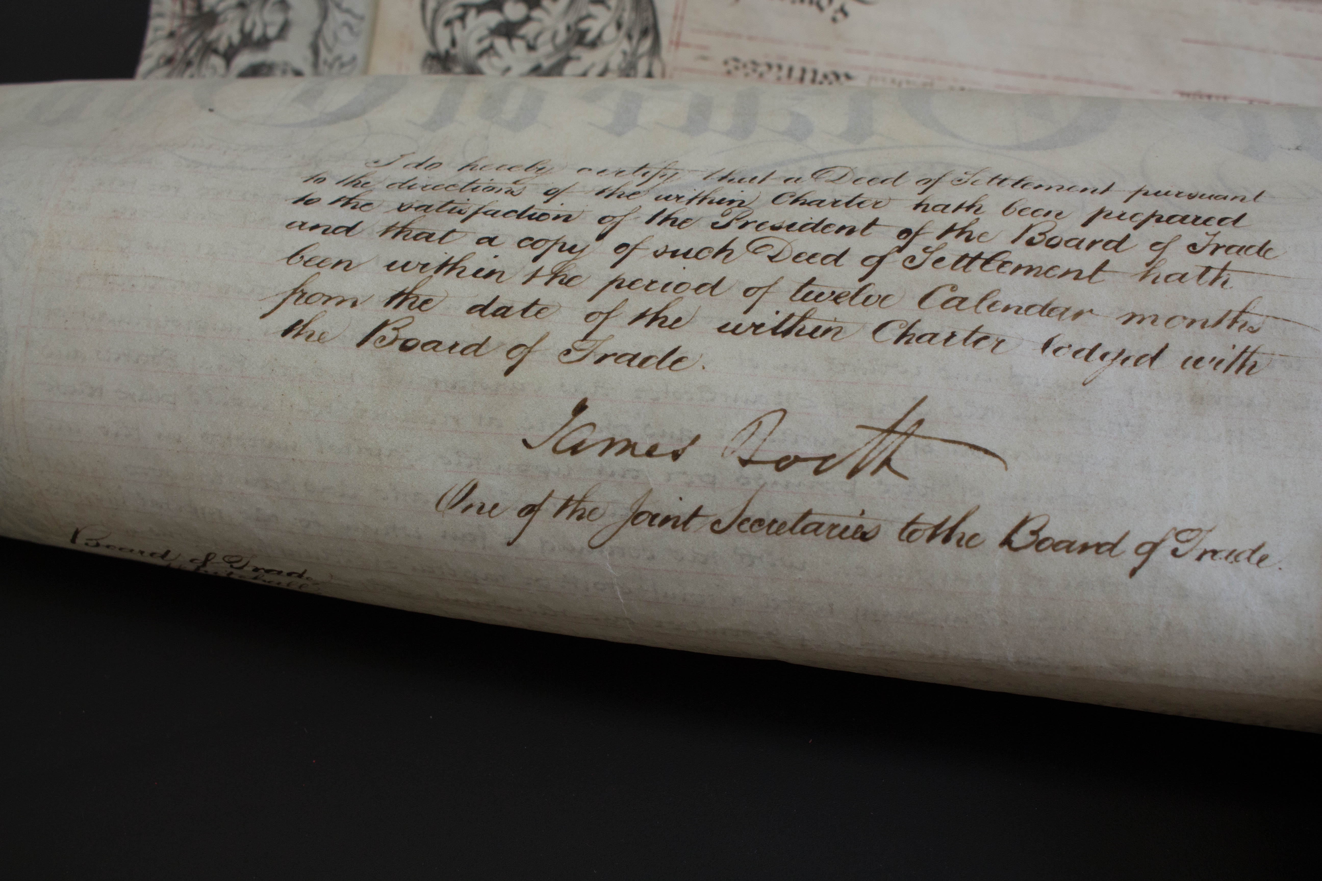 Photo of the back of the Charter with handwriting on it